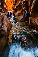 Hiking in a slot canyon en route to Kanarra Creek Falls, near Cedar City, Utah USA