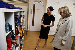 The Duchess of Sussex, looks at bags with Lady Juliet Hughes-Hallett, during her visit to Smart Works, in London, on the day that she has become their patron, as well as patron of the National Theatre, the Association of Commonwealth Universities, and the animal welfare charity, Mayhew.
