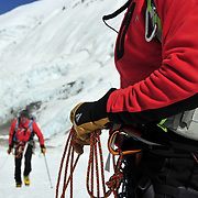 Peter Whittaker coils in Ed Viesturs as they approach the base of the Lhotse Face on Mount Everest.