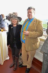 Left to right, JILLY COOPER and her son FELIX COOPER at the 2014 Hennessy Gold Cup at Newbury Racecourse, Newbury, Berkshire on 29th November 2014.  The Gold Cup was won by Many Clouds ridden by Leighton Aspell.