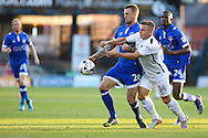 Sam Hoskins of Northampton Town and Peter Clarke of Oldham Athletic battle for the ball during the EFL Sky Bet League 1 match between Oldham Athletic and Northampton Town at Boundary Park, Oldham, England on 16 August 2016. Photo by Simon Brady.