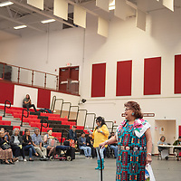 Felda Yazzie, an elder from Tse'ii'ahi (Standing Rock) walks the red carpet as she receives ovations from the crowd during the elder fashion show. The event was held in the Wellness Center in Crownpoint on May 07.