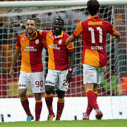 Galatasaray's celebrates his goal Sercan Yildirim, Emmanuel Eboue, Albert Riera Ortega (L-R) during their Turkish Super League soccer match Galatasaray between Akhisar Belediyespor at the TT Arena at Seyrantepe in Istanbul Turkey on Sunday 23 September 2012. Photo by TURKPIX