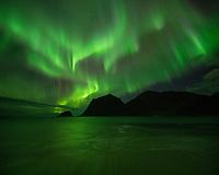 Northern lights - Aurora Borealis reflection on Vik beach, Vestvågøy, Lofoten Islands, Norway