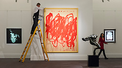 "© Licensed to London News Pictures. 08/04/2016. London, UK. A Sotheby's technician hangs Cy Twombly's ""Untitled (Bacchus 1st Version V)"", 2004, est. $20-30million.  Sotheby's auction preview, at their New Bond Street gallery, of works to be in the upcoming New York Impressionist, modern and contemporary art sale. Photo credit : Stephen Chung/LNP"