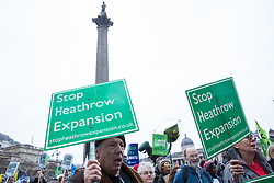 London, UK. 1st December, 2018. Neil Keveren of the No 3rd Runway Coalition marches with environmental campaigners on the Together for Climate Justice demonstration in protest against Government policies in relation to climate change, including Heathrow expansion and fracking. Following a rally outside the Polish embassy, chosen to highlight the UN's Katowice Climate Change Conference which begins tomorrow, protesters marched to Downing Street.