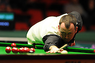 Mark Williams of wales in action during his 1st round match against Andy Hicks.Welsh open snooker, day 2 action at the Newport centre, Newport, South Wales on Tuesday 14th Feb 2012.  pic by Andrew Orchard, Andrew Orchard sports photography,