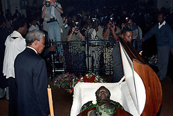 Nelson Mandela walks past the open casket of OR Tambo, who was Mandela's leader within the ANC. Photo Greg Marinovich