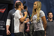 Liz Carmouche and Katlyn Chookagian face off during the UFC 205 weigh-ins at Madison Square Garden in New York, New York on November 11, 2016.  (Cooper Neill for The Players Tribune)