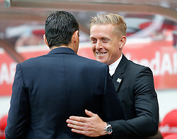 Head Coach Garry Monk of Swansea City is greeted by Manager Gustavo Poyet of Sunderland - Photo mandatory by-line: Rogan Thomson/JMP - 07966 386802 - 27/08/2014 - SPORT - FOOTBALL - Sunderland, England - Stadium of Light - Sunderland v Swansea City - Barclays Premier League.