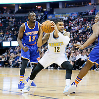 08 March 2016: Denver Nuggets guard D.J. Augustin (12) drives past New York Knicks guard Jerian Grant (13) and New York Knicks center Kevin Seraphin (1) during the Denver Nuggets 110-94 victory over the New York Knicks, at the Pepsi Center, Denver, Colorado, USA.