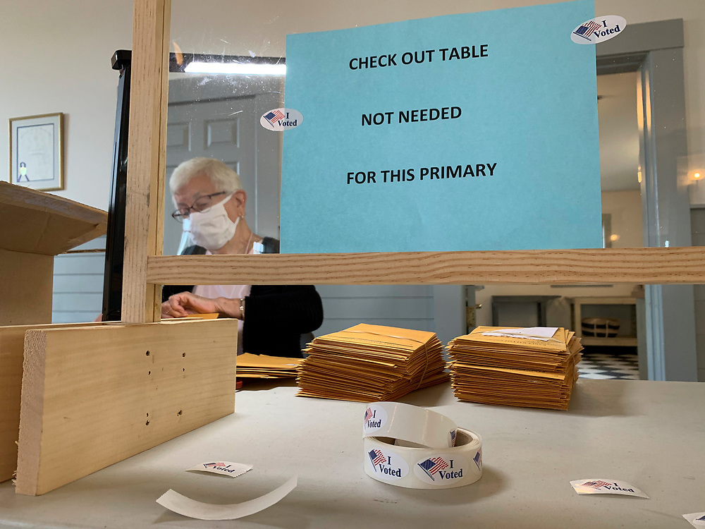Voters in the Commonwealth of Massachusetts cast absentee ballots and early vote ballots in record numbers. In smaller precincts, poll workers opened and processed the ballots.