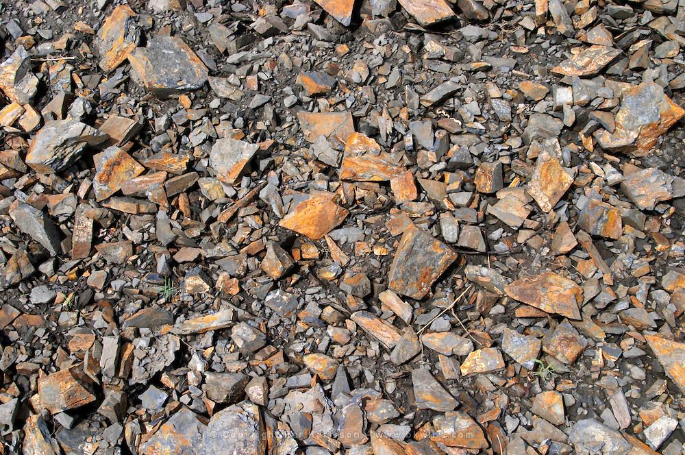 Soil detail. Slate. The black soil. Called Terres Brulees, burnt soil. Domaine Piquemal, Espira de l'Agly, Roussillon, France
