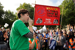 © Licensed to London News Pictures. 17/10/2013.  Bristol, UK.  Picture of Claire Nicholls, Young Teacher Officer for the National Union of Teachers speaking at a rally in Bristol's Queen's Square as teachers go on a one day strike in the south west of England in a series of strikes across the UK against plans by Government Minister Michael Gove to change teachers' pay, hours and pensions.  The strike was organised by the NUT and NASUWT trade unions, and teachers marched through the centre of Bristol to hold rallies. 17 October 2013.<br /> Photo credit : Simon Chapman/LNP