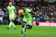 Raheem Sterling of Manchester city goes past Carlos Sanchez of Aston Villa (r). Barclays Premier league match, Aston Villa v Manchester city at Villa Park in Birmingham, Midlands  on Sunday 8th November 2015.<br /> pic by  Andrew Orchard, Andrew Orchard sports photography.