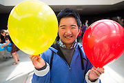 Alan Lee poses for a portrait with balloons during the Santa Clara County Super Hero Dance at Milpitas High School in Milpitas, California, on April 18, 2014. (Stan Olszewski/SOSKIphoto)
