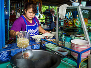 02 AUGUST 2018 - PAK KRET, NONTHABURI, THAILAND: A woman makes beef noodle soup in her restaurant on Ko Kret. Ko Kret (also spelled Koh Kret) is a small island in the Chao Phraya River in Nonthaburi province north of Bangkok. It is about 2 km long and 1 km wide. It has seven main villages, the largest and most populous being Ban Mon. Ko Kret was created in 1722 when a canal was dug in the Chao Phraya River to bypass a bend. Most of the people on the island are ethnically Mon, from the hills of western Thailand and eastern Myanmar (Burma). The island is popular as a weekend daytrip from Bangkok. The island is famous for the Mon style pottery made on the island.      PHOTO BY JACK KURTZ