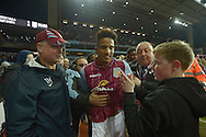 Scott Sinclair of Aston Villa, who scored his teams 2nd goal celebrates with fans after the final whistle as he walks off the field during a pitch invasion. The FA cup, 6th round match, Aston Villa v West Bromwich Albion at Villa Park in Birmingham, Midlands on Saturday 7th March 2015<br /> pic by John Patrick Fletcher, Andrew Orchard sports photography.