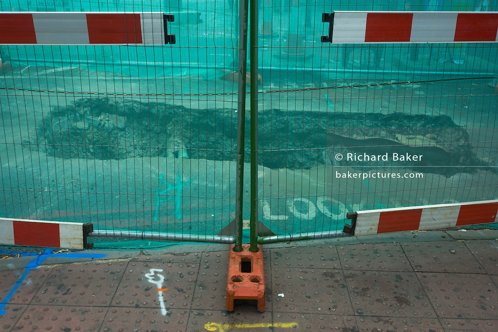 Roadworks and hole dug in central London.