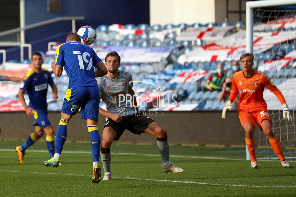 AFC Wimbledon attacker Shane McLoughlin (19) with header on target during the EFL Trophy Group O match between AFC Wimbledon and Charlton Athletic at the Kiyan Prince Foundation Stadium, London, England on 1 September 2020.