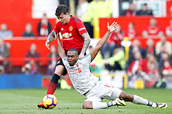 Manchester United's Victor Lindelof (left) and Liverpool's Daniel Sturridge battle for the ball during the Premier League match at Old Trafford, Manchester.