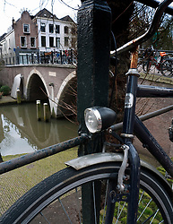 Detail of parked bicycles on street beside Oude Gracht or Old Canal in Utrecht The Netherlands