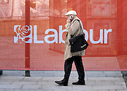 © Licensed to London News Pictures. 27/09/2011. LONDON, UK. A man talks on the phone in front of a labour party advertising hoarding. The Labour Party Conference in Liverpool today (27/09/11). Photo credit:  Stephen Simpson/LNP