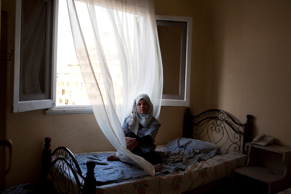 """On the night of March 9, Samira Ibrahim Mahmud was one of the women who was arrested along with Rasha Ali Abdulraham (image 2) while at a protest in Tahrir Square.  She, like Abdulraham, was subjected to a 'virginity test' while being held at the military detention center.  Released four days later, she traveled home to rural Upper Egypt, where she suffered for months from emotional trauma and stress in the aftermath of the incident.  But a few months later, she filed an official complaint against the Egyptian military.  About the incident Samira says, """"I know that to violate a woman in that way was considered rape. I felt like I had been raped.""""  Since filing the complaint on July 1, 2011, she says that she has received death threats on a near-daily basis in the form of phone calls and text messages.   She knows that the court case is an uphill battle, and likely a dangerous one, but she intends to fight.  Asked if she would ever consider leaving Egypt she responds immediately with """"No.  No, never."""""""