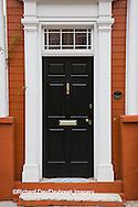 66512-00207 Black door on orange house. Charleston, SC