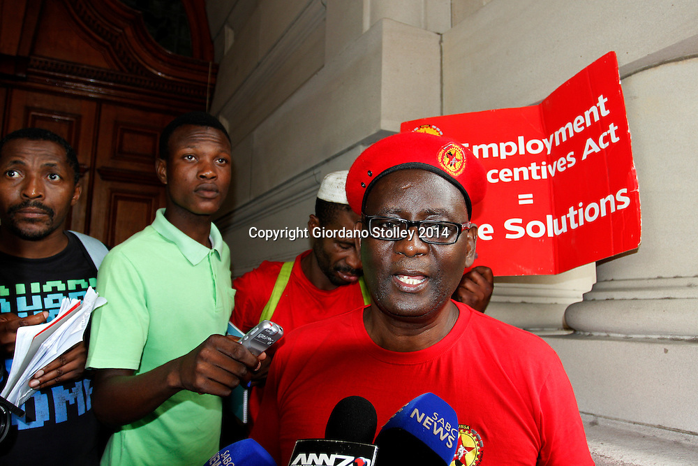 """DURBAN - 19 March 2014 - Zwelinzima Vavi, the suspended general secretary of the Congress of SA Trade Unions federations, speaks to reporters at the Durban City Hall following a march of several thousand members of the  National Union of Metal Workers of South Africa through central Durban to protests for more jobs. Asked to comment on the Public Protector's report on President Jacob Zuma's Nkandla residence, he said that: """"""""I can never ever agree to suddenly call a swimming pool a fire pool. Nor will I agree that we must call an amphitheatre a wall with steps."""" Picture: Allied Picture Press/APP"""