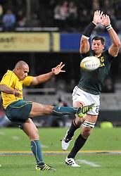 Mr Price Kings Park Stadium, Durban. Tri-Nations Springboks vs Australia. Bok eighthman Pierre Spies tries to charge down a kick from Australian scrumhalf Will Genia. Picture: Etienne Rothbart.