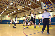 UK, Chelmsford - Thursday, March 05, 2009: Piotr Prazych shoots over an Eagle defender during the Essex Basketball League game Erkenwald at Baddow Eagles. Erkenwald won the game 94 - 75. (Image by Peter Horrell / http://www.peterhorrell.com)