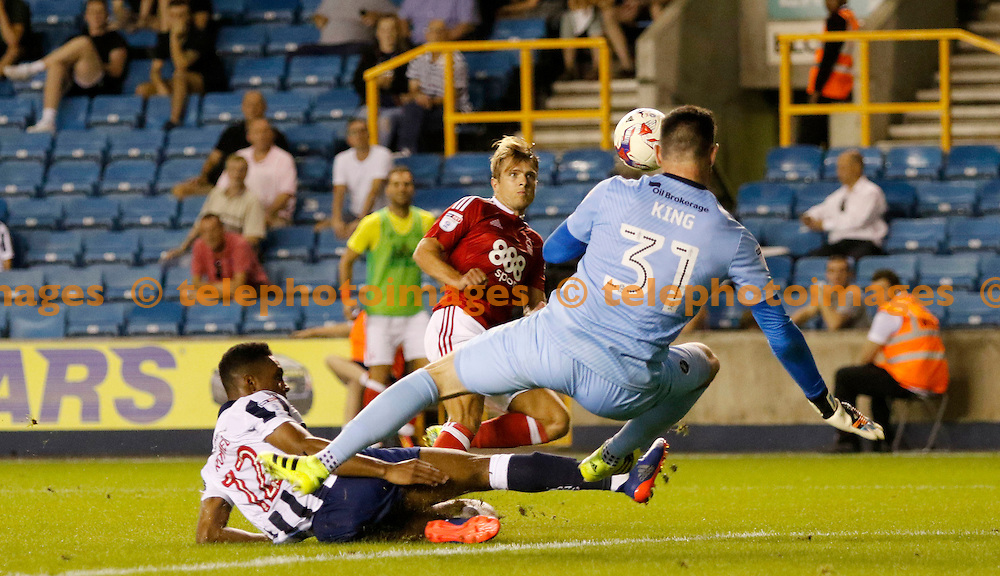 Nottingham Forest's Jamie Ward has his shot saved during the EFL Cup match between Millwall and Nottingham Forest at The Den in London. August 23, 2016.<br /> Carlton Myrie / Telephoto Images<br /> +44 7967 642437