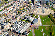 Nederland, Noord-Holland, Amsterdam, 09-04-2014;<br /> Het Museumplein en Museumkwartier. Onder Stedelijk Museum , dan het Van Goghmuseum en de achterkant van het Rijksmuseum met fietstunnel (rechtsboven). <br /> View on the Museumplein. From bottom left (CW) the Stedelijk Museum, Van Goghmuseum and the rear side of the Rijksmuseum.<br /> luchtfoto (toeslag op standard tarieven);<br /> aerial photo (additional fee required);<br /> copyright foto/photo Siebe Swart