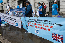 London, UK. 5th August, 2021. Activists from Uyghur Solidarity Campaign UK and other supporting groups protest opposite the Chinese embassy in support of the Uyghur people's struggle for freedom. Activists highlighted the Chinese government's persecution and forced assimilation of Uyghurs, Kazakhs and other indigenous people in East Turkestan and Xinjiang and called for them to have the right to determine their own futures through a democratic process.