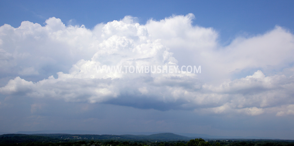 Hamptonburgh, NY - Cumulonimbus clouds form in the sky above the Hudson Valley region of New York on a warm summer afternoon on July 11, 2009.