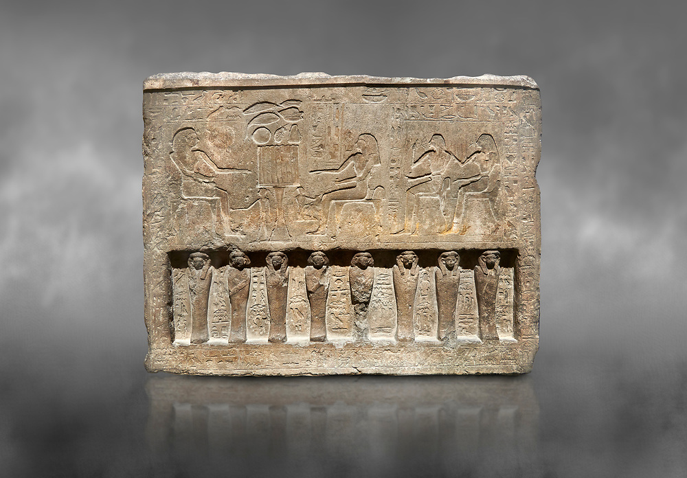 Ancient Egyptian stele of the official Saherhotep & his wife Ipet, limestone, Middle Kingdom, 19th Dynasty, (1759-1700 BC), Old Fund cat 1630. Egyptian Museum, Turin. Grey backgtound.<br /> <br /> 8 mummiform figure in high relief run along the bottom of the stele. .<br /> <br /> If you prefer to buy from our ALAMY PHOTO LIBRARY  Collection visit : https://www.alamy.com/portfolio/paul-williams-funkystock/ancient-egyptian-art-artefacts.html  . Type -   Turin   - into the LOWER SEARCH WITHIN GALLERY box. Refine search by adding background colour, subject etc<br /> <br /> Visit our ANCIENT WORLD PHOTO COLLECTIONS for more photos to download or buy as wall art prints https://funkystock.photoshelter.com/gallery-collection/Ancient-World-Art-Antiquities-Historic-Sites-Pictures-Images-of/C00006u26yqSkDOM