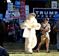 Oct 19, 2016. Las Vegas NV. A guy in a polar bear suit arrives at the UNLV rally Wednesday. Today will be the 3rd and final presidential debate between Republican presidential nominee Donald Trump and Democratic presidential nominee Hillary Clinton at Las Vegas Nevada University. .Photo by Gene BlevinsZumaPress (Credit Image: © Gene Blevins via ZUMA Wire)
