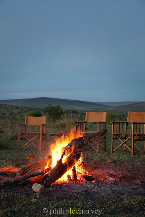 A campfire prepared for sundowners, drinks after a day of safari, in Cottars Conservancy, near the Maasai Mara National Reserve in Kenya