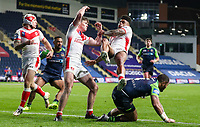 St Helens' Kevin Naiqama is upended in the air <br /> <br /> Photographer Alex Dodd/CameraSport<br /> <br /> Rugby League - Betfred Challenge Cup Quarter Finals - St Helens v Huddersfield Giants - Friday 7th May 2021 - Emerald Headingley Stadium - Leeds<br /> <br /> World Copyright © 2021 CameraSport. All rights reserved. 43 Linden Ave. Countesthorpe. Leicester. England. LE8 5PG - Tel: +44 (0 116 277 4147 - admin@camerasport.com - www.camerasport.com