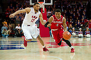 DALLAS, TX - JANUARY 21: Myles Mack #4 of the Rutgers Scarlet Knights drives to the basket past Nick Russell #12 of the SMU Mustangs on January 21, 2014 at Moody Coliseum in Dallas, Texas.  (Photo by Cooper Neill/Getty Images) *** Local Caption *** Myles Mack; Nick Russell