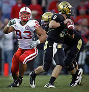 SHOT 11/27/09 4:35:03 PM - Nebraska Cornhuskers defensive tackle Ndamukong Suh (#93) goes after Colorado quarterback Tyler Hansen (#9) during the second half of their game at Folsom Field in Boulder, Co. Nebraska won the game 28-20. Suh is one of the top players in the nation, a candidate for the Heisman trophy and a likely top NFL draft pick. (Photo by Marc Piscotty / © 2009)