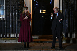 © Licensed to London News Pictures. 03/02/2021. London, UK. CARRIE SYMONDS and British Prime Minister BORIS JOHNSON takes part in a national clap for Captain Sir Tom Moore and healthcare workers. Sir Tom died yesterday from Covid-19. The 100 year old former soldier will be remembered for raising over £32 million for the National Health Service during the first Coronavirus lockdown in 2020. Photo credit: Ray Tang/LNP