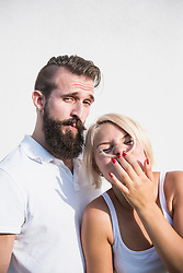 Young man with his playful girlfriend making moustache with hair, Bavaria, Germany