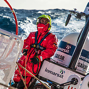Leg 7 from Auckland to Itajai, day 06 on board MAPFRE, Blair Tuke with a big wave behind. 23 March, 2018.