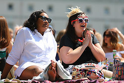 © Licensed to London News Pictures. 19/05/2018. London, UK. Wellwishers celebrate the Royal Wedding at an outdoor screening at the National Maritime Museum in Greenwich. Prince Harry is getting married to Meghan Markle today in Windsor. Photo credit: Rob Pinney/LNP