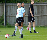 Photo: Daniel Hambury.<br />Tottenham Hotspur training session. 07/09/2006.<br />Spurs manager Martin Jol plays with the ball during training.