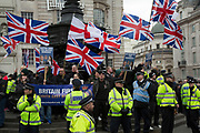 Members of Britain First in being protected by a ring of police during counter protest at Anti-racism Day demonstration led by Stand Up To Racism on 19th March 2016 in London, United Kingdom. Stand Up To Racism has led some of the biggest anti-racist mobilisations in Britain of the last decade, making a stand protesting against racism, Islamophobia, anti-Semitism and fascism.