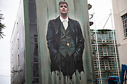 Peaky Blinders street art graffiti in Digberth, Birmingham, United Kingdom. Peaky Blinders is a British crime drama television series created by Steven Knight, that premiered on BBC Two on 12 September 2013. The series is primarily set in Birmingham, England, and follows the exploits of the Shelby crime family in the aftermath of World War I. Digbeth is an area of Central Birmingham, England. Following the destruction of the Inner Ring Road, Digbeth is now considered a district within Birmingham City Centre. As part of the Big City Plan, Digbeth is undergoing a large redevelopment scheme that will regenerate the old industrial buildings into apartments, retail premises, offices and arts facilities. There is still however much industrial activity in the south of the area.