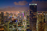 Aerial view of Miami at twilight looking north on Brickell Avenue showing the financial district and downtown Miami in the distance.